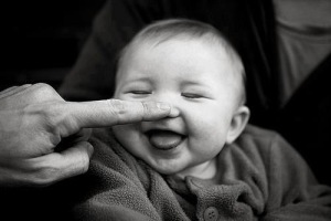 finger-touching-nose-of-baby